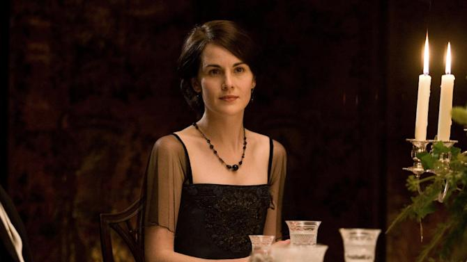 """In this image released by PBS, Michelle Dockery portrays Lady Mary in a scene from """"Downton Abbey."""" Dockery was nominated for an Emmy Award for best actress in a drama series on Thursday July 10, 2014. The 66th Primetime Emmy Awards will be presented Aug. 25 at the Nokia Theatre in Los Angeles. (AP Photo/PBS, Carnival Film & Television Limited 2011 for MASTERPIECE)"""