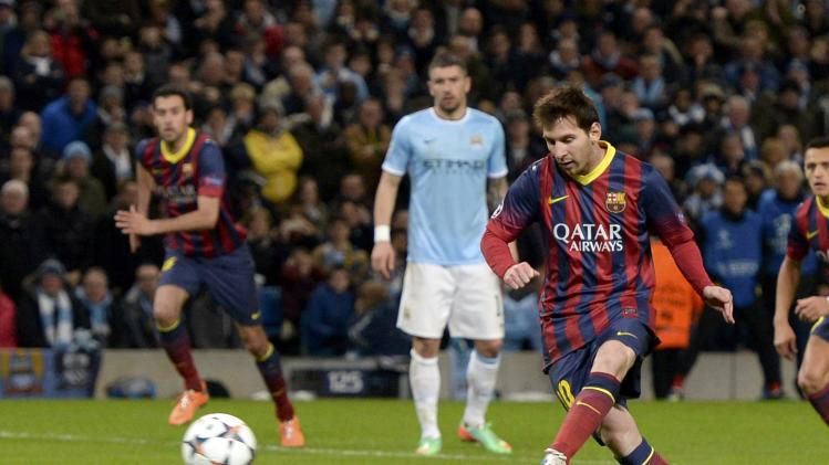 Barcelona's Lionel Messi scores a penalty against Manchester City during their Champions League round of 16 first leg soccer match at the Etihad Stadium in Manchester