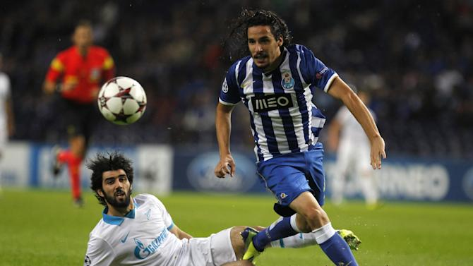 "Porto's Luis ""Lica"" Carneiro, right, vies for the ball with Zenit's Luis Neto, from Portugal, during the Champions League group G soccer match between FC Porto and Zenit at the Dragao stadium in Porto, northern Portugal, Tuesday, Oct. 22, 2013. Zenit won 1-0"