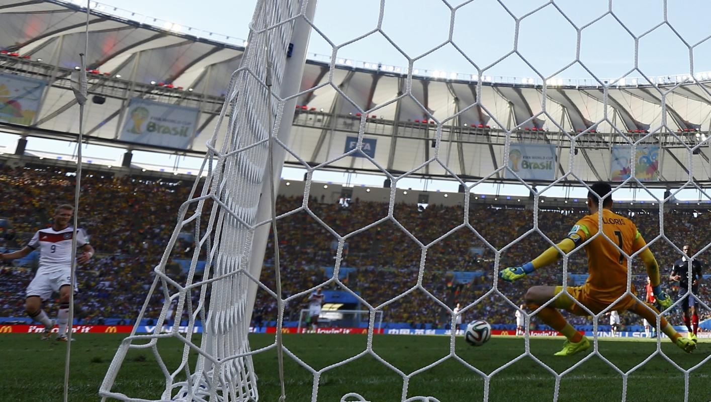 France's goalkeeper Hugo Lloris saves a shot by Germany's Andre Schuerrle during their 2014 World Cup quarter-finals at the Maracana stadium...