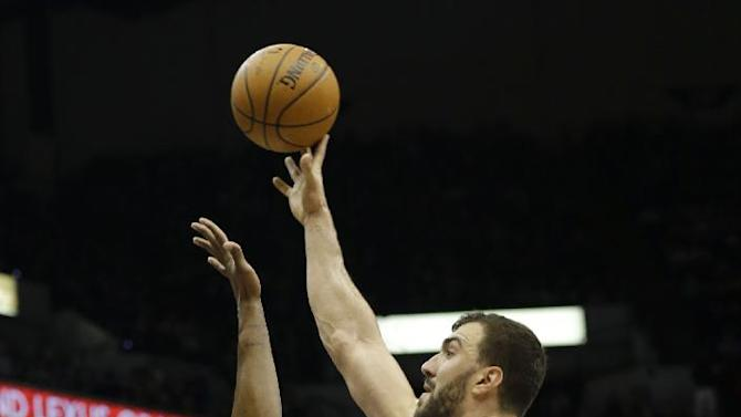 Minnesota Timberwolves center Nikola Pekovic, right, of Montenegro, goes up over Miami Heat center Chris Bosh for a shot during the third quarter of an NBA basketball game in Minneapolis, Saturday, Dec. 7, 2013. The Heat won 103-82