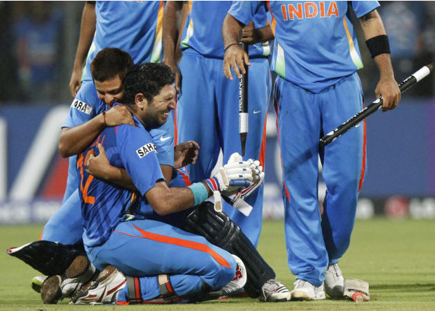 India's Yuvraj Singh, left, is emotional as he is embraced by teammate Suresh Rainai after winning the Cricket World Cup final match between Sri Lanka and India in Mumbai, India, Saturday, April 2, 20
