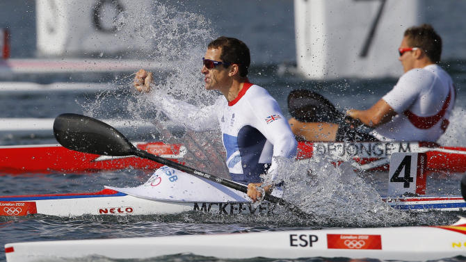 Britain's Ed Mckeever celebrates winning the men's kayak single (K1) 200m final A at the Eton Dorney during the London 2012 Olympic Games