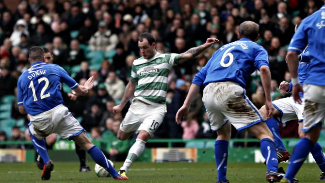 Celtic's Stokes scores his third goal against St Johnstone during their Scottish Premier League match in Glasgow
