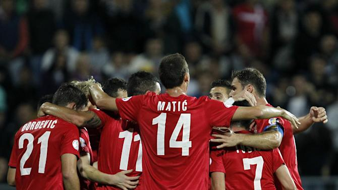 Serbian players celebrate after their goal during their World Cup 2014 Group A qualifying soccer match against Macedonia, at the City Stadium in Jagodina, Serbia, Tuesday, Oct. 15, 2013
