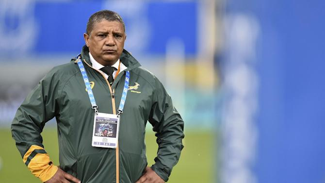 "FILE - In this Saturday, Nov. 16, 2016 file photo, South Africa coach Allister Coetzee waits for the start of the international rugby union test match against Italy, in Florence, Italy. South African rugby has taken the first few steps on a ""hard"" road to change, with its decision-making general council voting to reduce some of its own powers. Among the changes approved on Friday, Dec. 9, 2016 by SA Rugby's general council _ made up of representatives from each of the 14 provincial unions _ was giving up the power to appoint the national team coach. (AP Photo/Andrea Staccioli, File)"
