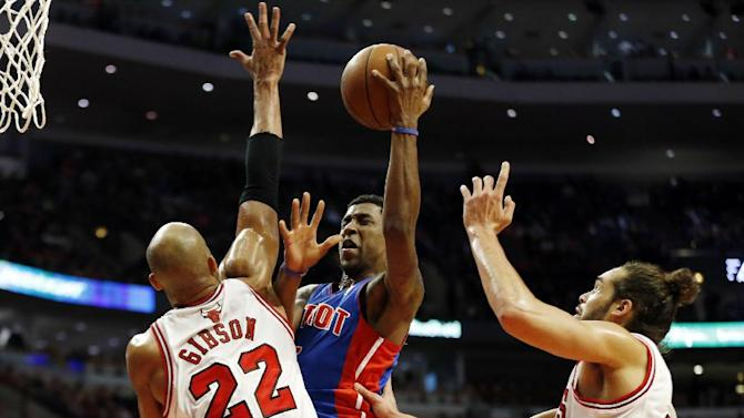 Detroit Pistons guard Kentavious Caldwell-Pope, center, goes to the basket between Chicago Bulls forward Taj Gibson, left, and center Joakim Noah, right, during the second half of an NBA basketball game in Chicago, Saturday, Dec. 7, 2013. The Pistons won 92-75