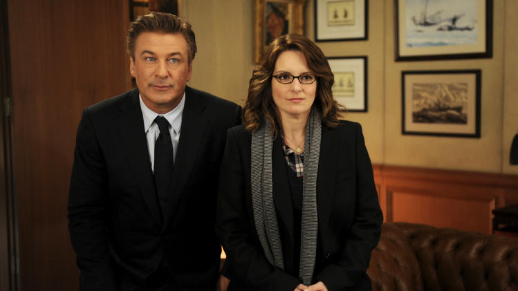"In this 2011 image released by NBC, Alec Baldwin portrays Jack Donaghy, left, and Tina Fey portrays Liz Lemon in the NBC comedy series, ""30 Rock."" NBC says ""30 Rock"" will be returning next season for a final, abbreviated run. (AP Photo/NBC, Ali Goldstein)"