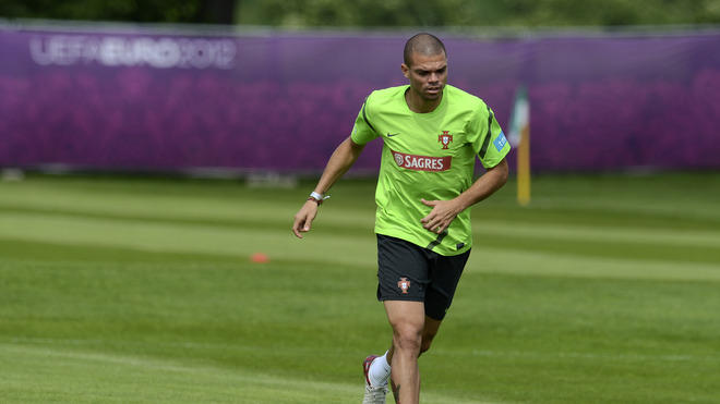 Portuguese Defender Pepe Warms AFP/Getty Images