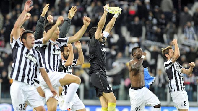 Juventus players celebrate at end of a Serie A soccer match between Juventus and Napoli at the Juventus stadium, in Turin, Italy, Sunday, Nov. 10, 2013. Juventus won 3-0