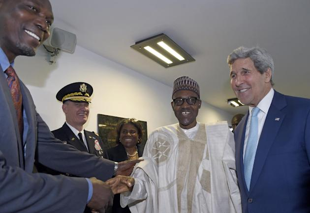 U.S. Secretary of State John Kerry, right, introduces newly inaugurated Nigerian President Muhammadu Buhari, second from right, to Hakeem Olajuwon, left, NBA Legend and Olympic Gold Medalist, before t