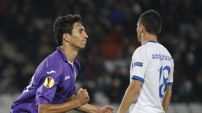 Fiorentina's Ryder Matos, left, celebrates after scoring an equalizer during a Europa League, group E match, between Fiorentina and Pandurii, at the Cluj Arena stadium in Cluj, Romania, Thursday, Nov. 7,  2013