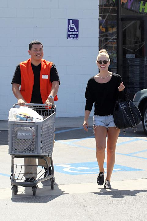 Take a cue from Ali Larter: short shorts, red lipstick and a friendly smile get your groceries delivered to your car. (Smith Jones/PCN)