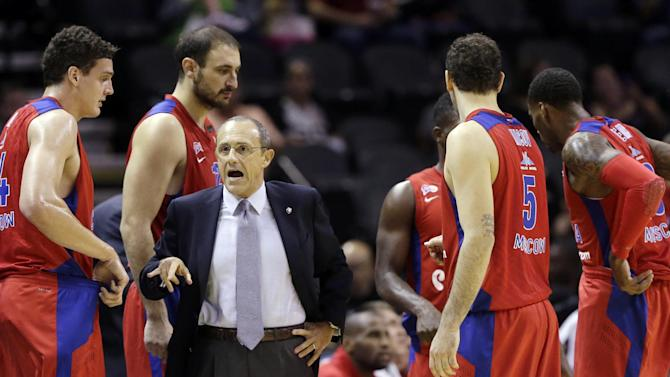 CSKA Moscow coach Ettore Messina, center, talks to his team during a timeout in the second half of an exhibition NBA basketball game against the San Antonio Spurs, Wednesday, Oct. 9, 2013, in San Antonio. San Antonio won 95-93 in overtime