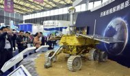 Visitors take pictures of a prototype model of a lunar rover at the 15th China International Industry Fair in Shanghai, November 5, 2013. REUTERS/Stringer