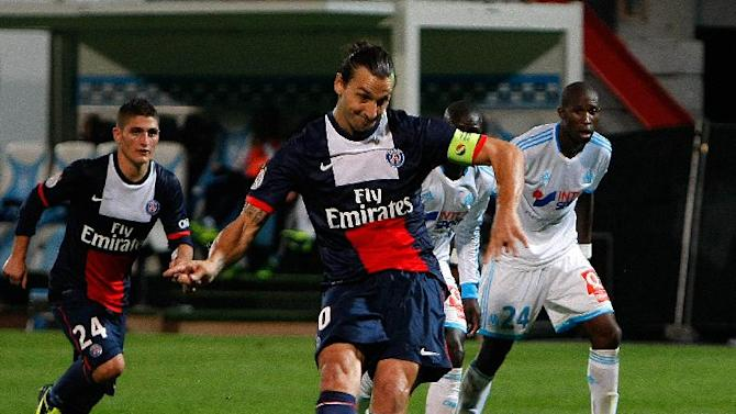 Paris Saint Germain's Swedish forward Zlatan Ibrahimovic, scores a penalty against Marseille, during their League One soccer match, at the Velodrome Stadium, in Marseille, southern France, Sunday, Oct. 6, 2013