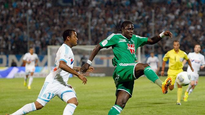 Marseille's Ghanaian forward Jordan Ayew, left, challenges for the ball with Saint-Etienne's Senegalese defender Moustapha Sall during their League One soccer match at the Velodrome Stadium, in Marseille, southern France, Tuesday, Sept. 24, 2013