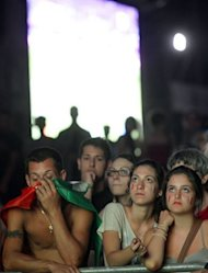 Italian supporters show their disappointment in front of a giant screen during the Euro 2012 final between opposing Italy and Spain in Rome, July 1. Defending champions Spain secured an unprecedented third successive major trophy as they beat Italy 4-0 in the Euro 2012 final in Kiev