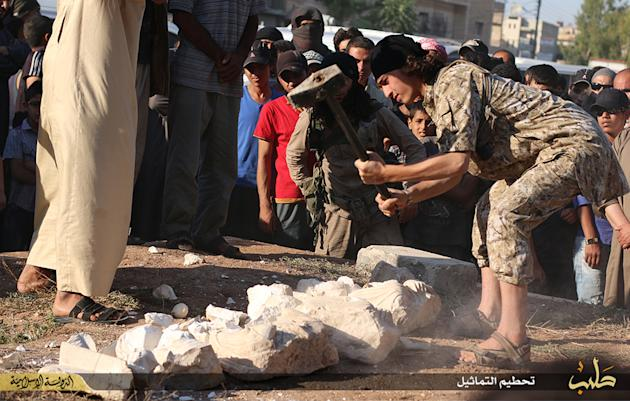 In this image posted on a militant website by the Aleppo branch of the Islamic State group on Friday, July 3, 2015, which has been verified and is consistent with other AP reporting, a militant smashe