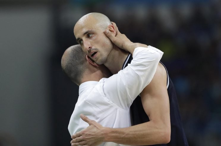 Argentina head coach Sergio Santos Hernandez, left, hugs Manu Ginobili, right, as he comes off the court during a men's quarterfinal round basketball game against the United States at the 2016 Summer Olympics in Rio de Janeiro, Brazil, Wednesday, Aug. 17, 2016. (AP Photo/Eric Gay)