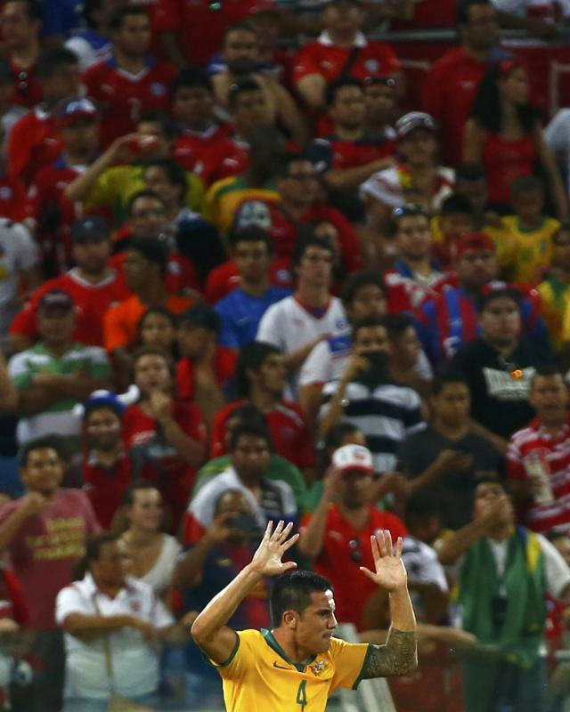 Australia's Cahill celebreates after scoring a goal against Chile during their 2014 World Cup Group B soccer match at the Pantanal arena in Cuiaba
