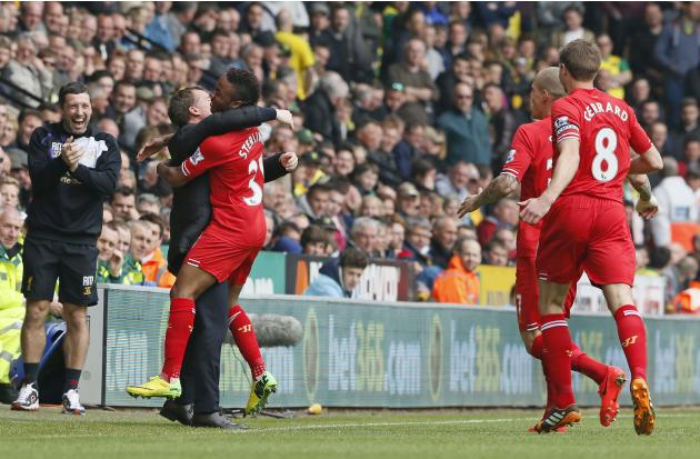 Liverpool's Sterling celebrates his goal against Norwich City with with manager Rodgers during their English Premier League soccer match at Carrow Road in Norwich