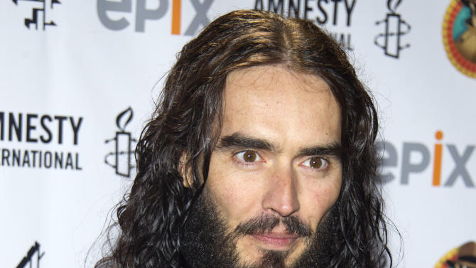 "FILE - In this March 4, 2012 file photo, Russell Brand arrives to Amnesty International's ""Secret Policeman's Ball"" in New York. The MTV network says the 36-year-old comedian will host the 2012 MTV Movie Awards June 3, 2012. (AP Photo/Charles Sykes, file)"