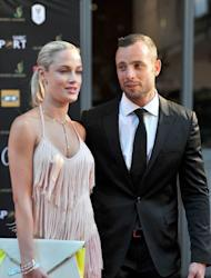 Oscar Pistorius and his model girlfriend Reeva Steenkamp on November 4, 2012 in Johannesburg. Steenkamp, 29, was shot four times in the early hours of Thursday by a 9mm pistol owned by the sprinter