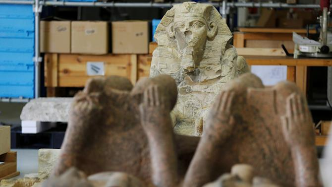 Pharaonic ancient Egyptian artifacts are seen under renovation in the conservation centre of the Grand Egyptian Museum on the outskirts of Cairo