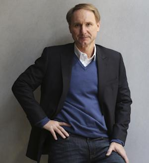 "In this Monday, May 13, 2013 photo, author Dan Brown poses for a portrait in New York. His new book, ""Inferno,"" published by Doubleday releases on May 14, 2013.   (AP Photo/Seth Wenig)"