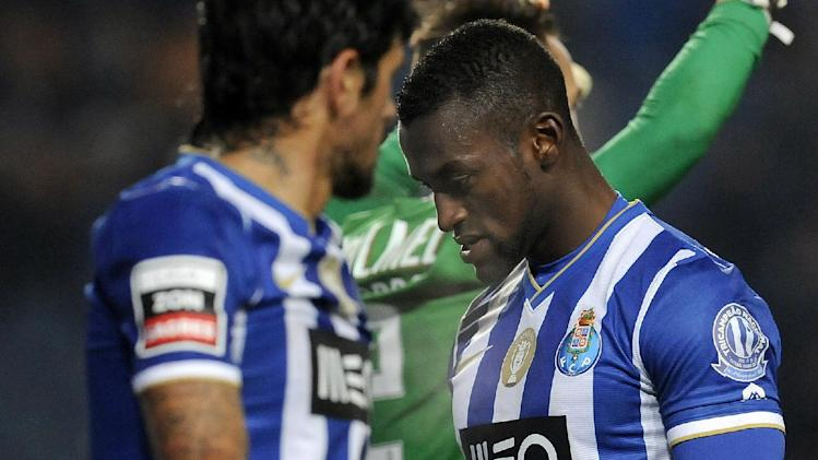 FC Porto's Jackson Martinez, right, from Colombia and Lucho Gonzalez, from Argentina, react after missing a shot against Academica in a Portuguese League soccer match at the Municipal Stadium in Coimbra, Portugal, Saturday, Nov. 30, 2013. Academica won 1-0 causing Porto's first defeat in the championship