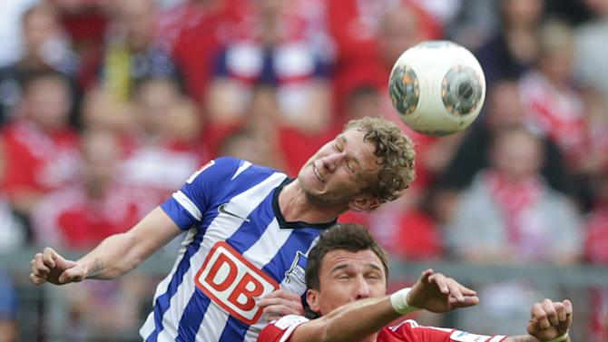 Berlin's Adrian Ramos of Colombia, top, and Bayern's Mario Mandzukic of Croatia  challenge for the ball during the German first division Bundesliga soccer match between FC Bayern Munich and Hertha BSC Berlin, in Munich, southern Germany, Saturday, Oct. 26, 2013