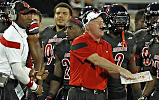 Bobby Petrino's defense held Miami to 246 yards total on Monday. (AP)