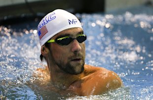 Michael Phelps checks his time in the 200 freestyle in a preliminary race at the Arena Pro Swim Series meet in Charlotte, N.C, Friday, May 15, 2015. Phelps qualified fourteenth with a time of 1:51:44. (AP Photo/Nell Redmond)