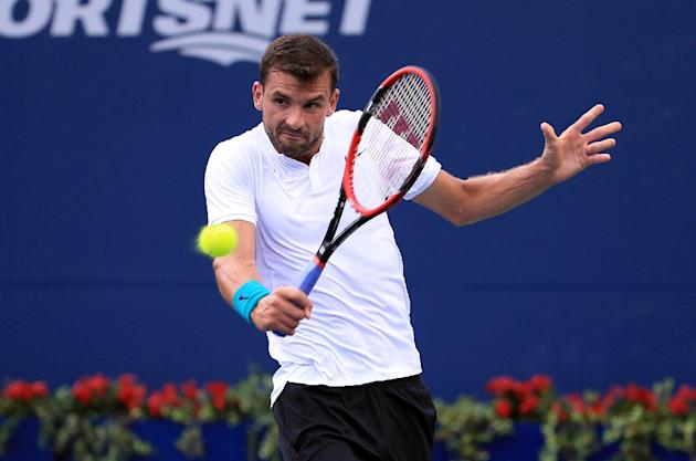 Tennis - Determined Dimitrov fights through in Canada