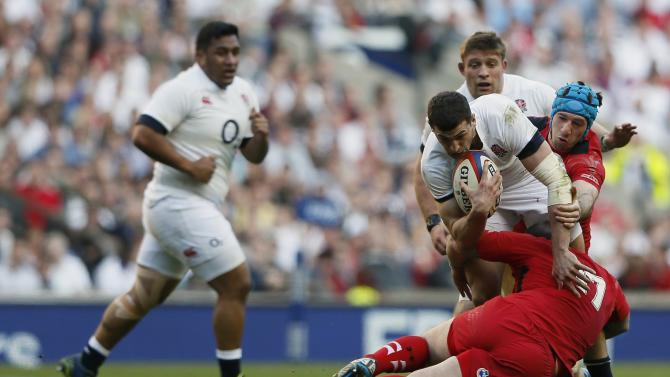 England's May is tackled by Wales' James during their Six Nations international rugby union match at Twickenham in London