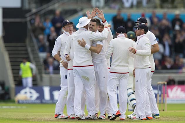 England's James Anderson, centre left, celebrates with teammates after taking the wicket of Australia's Mitchell Johnson, caught on 3 by Ben Stokes on the first day of the third test match of