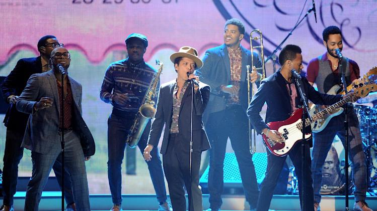 Singer Bruno Mars performs during the 2012 Victoria's Secret Fashion Show on Wednesday Nov. 7, 2012 in New York. The show will be broadcast on Tuesday, Dec. 4 (10:00 PM, ET/PT) on CBS. (Photo by Evan Agostini/Invision/AP)