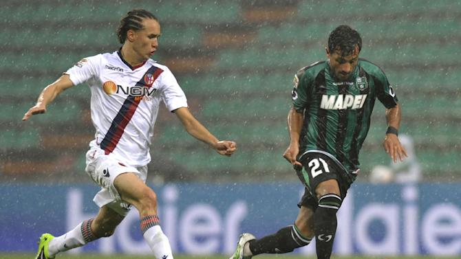 Sassuolo's Karim Laribi, right, runs with the ball away from Bologna's Diego Laxalt, of Uruguay, during their Serie A soccer match at Reggio Emilia's Mapei stadium, Italy, Sunday, Oct. 20, 2013
