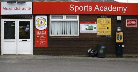 Signs are seen at the Crewe Alexandra Football Club ground in Crewe
