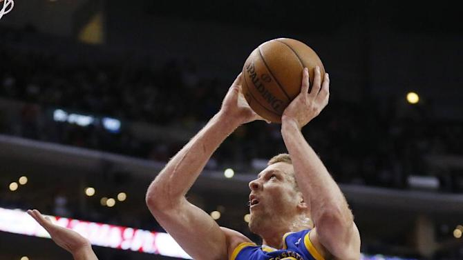 Golden State Warriors' David Lee, right, shoots against Los Angeles Clippers' Blake Griffin during the first half of an NBA basketball game in Los Angeles, Wednesday, March 12, 2014
