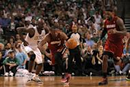 BOSTON, MA - JUNE 07: Dwyane Wade #3 of the Miami Heat drives up court with teammate LeBron James #6 against Kevin Garnett #5 of the Boston Celtics in Game Six of the Eastern Conference Finals in the 2012 NBA Playoffs on June 7, 2012 at TD Garden in Boston, Massachusetts. NOTE TO USER: User expressly acknowledges and agrees that, by downloading and or using this photograph, User is consenting to the terms and conditions of the Getty Images License Agreement. (Photo by Jim Rogash/Getty Images)
