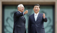 Prime Minister Datuk Seri Najib Razak (left) went on a six-day visit to China in June to meet President Xi Jinping (right) and China's Prime Minister Li Keqiang. — Reuters pic