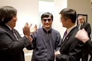 In handout photograph from the US Embassy Beijing Press office, Chinese dissident Chen Guangcheng (C) shakes hands with Gary Locke (R), US ambassador to China in Beijing. Chen appealed to US President Barack Obama to help get him and his family out of China, just hours after leaving the US embassy in Beijing in a deal with Chinese officials