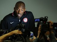 Kobe Bryant of the US basketball national team attends a press conference in London. LeBron James,Bryant and other NBA stars are pleading their case to keep the Olympics from becoming a 23-and-under event but there are indications the superstars' advice is falling upon deaf ears