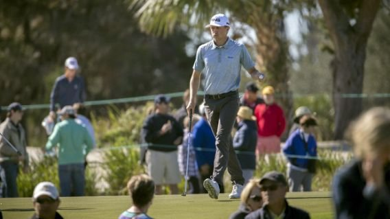 Mackenzie Hughes, of Canada, reacts to his putt on the first green during the final round at the RSM Classic golf tournament, Sunday, Nov. 20, 2016, in St. Simons Island, Ga. (AP Photo/Stephen B. Morton)