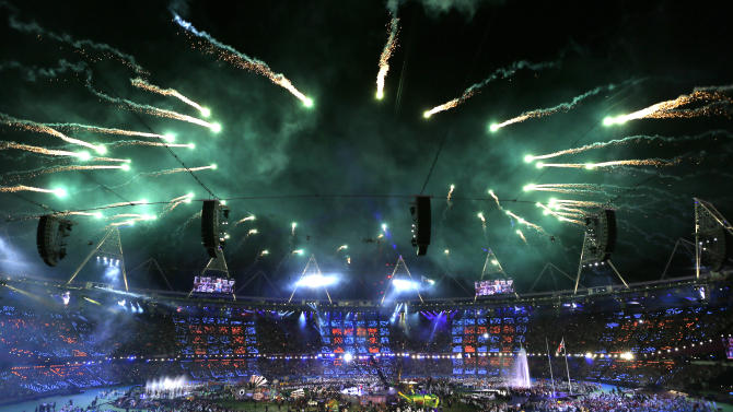 Fireworks explode over the stadium as rock band Coldplay perform at the closing ceremony for the 2012 Paralympics, Sunday, Sept. 9, 2012, in London. (AP Photo/Kirsty Wigglesworth)