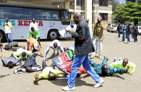 Protesting Kenyan athletes are seen inside the compound of Riadha House where the leadership of Athletic Kenya operates from in capital Nairobi