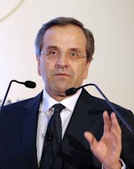 Greece's Prime Minister Antonis Samaras talks during his keynote address as part of the International Herald Tribune Global Conversation in Paris on October 4. Samaras and German Chancellor Angela Merkel are to meet representatives of the Greek and German business communities during a trip to Greece by the German leader.
