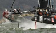 Emirates Team New Zealand (L) trails Oracle Team USA at the the first mark during Race 5 of the 34th America's Cup yacht sailing race in San Francisco, California September 10, 2013. REUTERS/Robert Galbraith